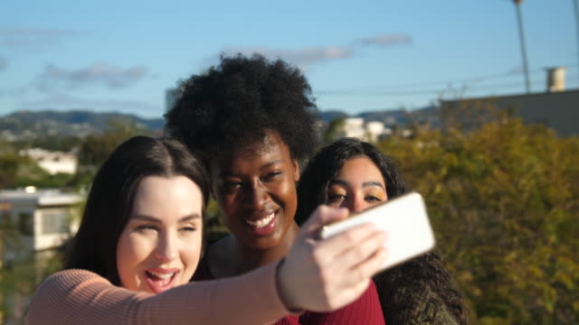 cheerful female friends taking selfies outdoors - body positive stock videos & royalty-free footage