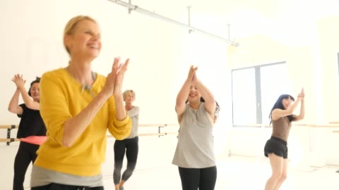 cheerful females practicing dance in fitness club - mixed race person stock videos & royalty-free footage