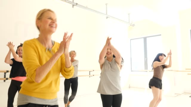 cheerful females practicing dance in fitness club - dance studio stock videos & royalty-free footage