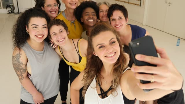 cheerful females taking selfie in dance class - scienza e tecnologia video stock e b–roll