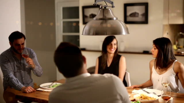 cheerful friends at the dinner party. - loft apartment stock videos & royalty-free footage