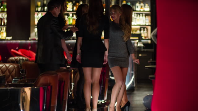 cheerful friends dancing in nightclub - bar counter stock videos & royalty-free footage