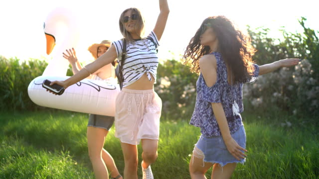cheerful friends enjoying summer day together - rubber ring stock videos & royalty-free footage