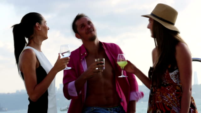 cheerful friends having fun on a yacht - nautical vessel stock videos & royalty-free footage