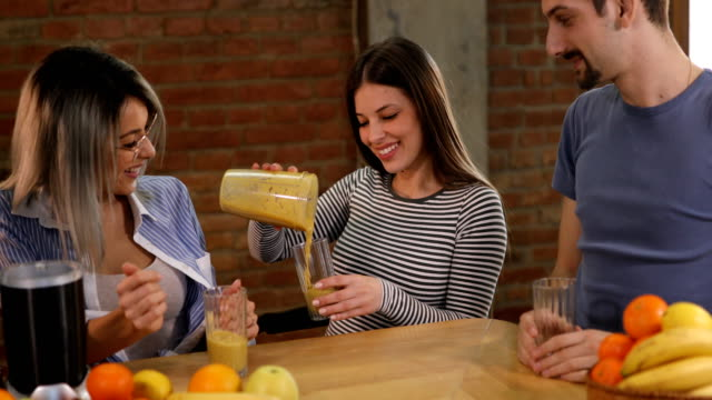 cheerful friends making fruit smoothie - juice drink stock videos & royalty-free footage
