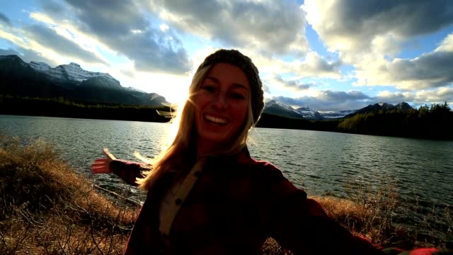 Cheerful girl capturing beautiful moments in nature