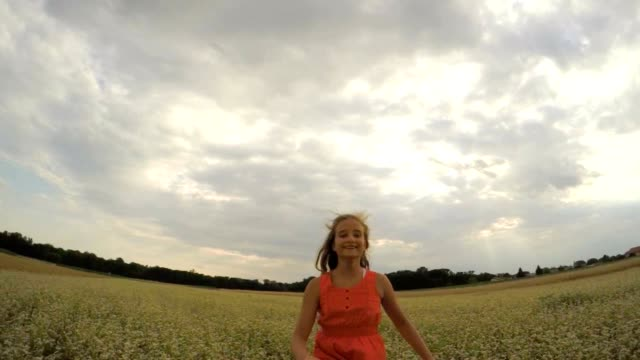 POV Cheerful girl in the middle of buckwheat field