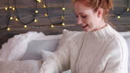 Cheerful girl opening christmas gifts