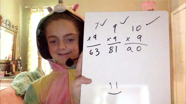 cheerful girl wearing unicorn onesie holds up math problems on whiteboard during online class - remote location stock videos & royalty-free footage