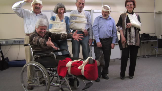 hd: cheerful group of injured seniors - survival stock videos and b-roll footage