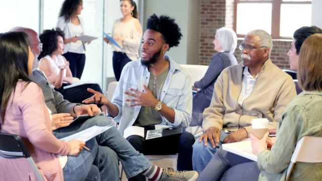 cheerful group of people participate in community focus group - teasing stock videos & royalty-free footage
