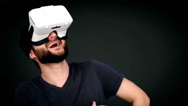 cheerful grown man with glasses laughing virtual reality of what he saw