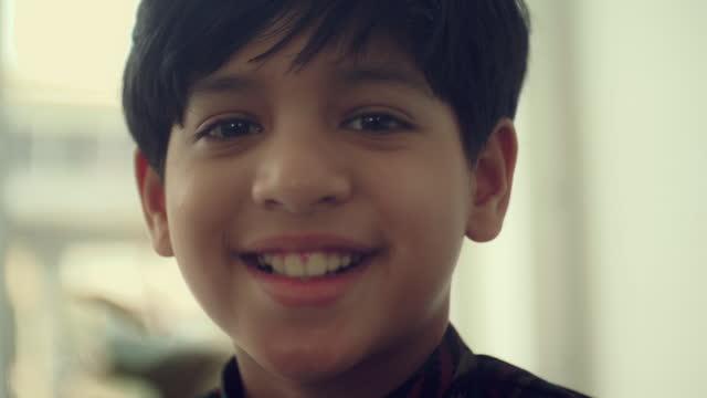 cheerful indian boy - teenage boys stock videos & royalty-free footage