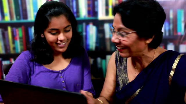 cheerful indian senior woman with her grandaughter using laptop - indian ethnicity stock videos & royalty-free footage