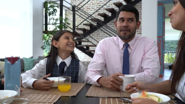 cheerful latin american family eating breakfast together while talking and smiling - serving size stock videos & royalty-free footage
