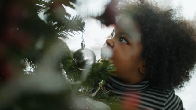 cheerful little afro girl at home at christmas time - 2 3 years stock videos & royalty-free footage
