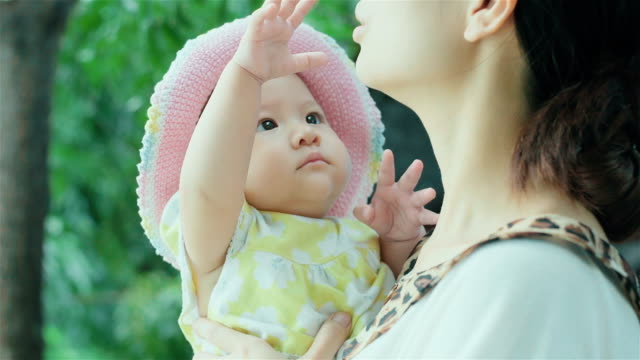 cheerful little asian baby girl and her mother - 6 11 mesi video stock e b–roll