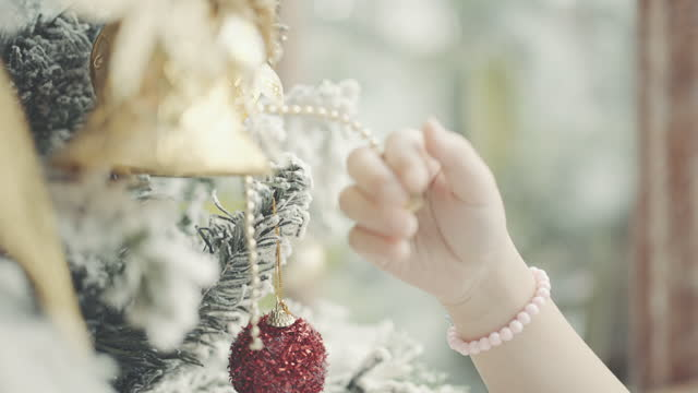 cheerful little girl decorating christmas tree - 6 7 years stock videos & royalty-free footage