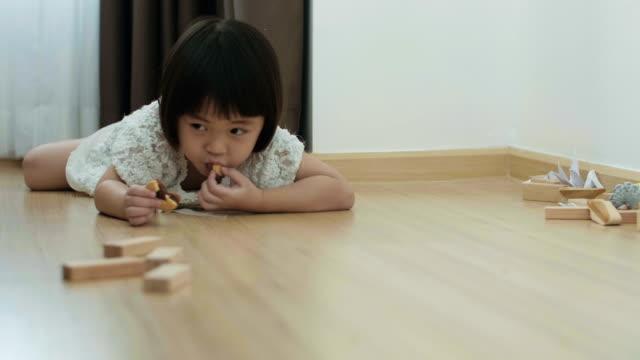 cheerful little girls on the floor - flooring stock videos & royalty-free footage