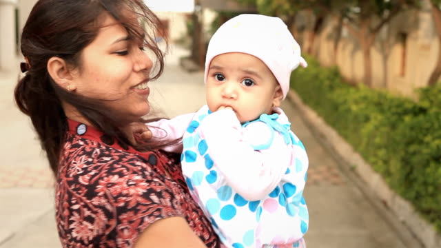 cheerful little indian girl and her mother - indian mom stock videos & royalty-free footage