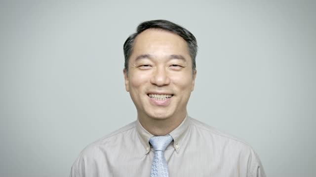 Cheerful male entrepreneur wearing shirt and tie