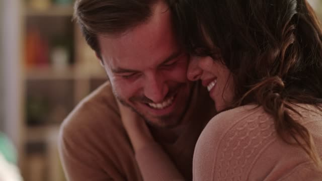 vídeos de stock e filmes b-roll de cheerful married couple sharing romantic kisses and cuddles on a valentine's day date - carinhoso
