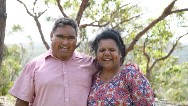 Cheerful mature Aborigine couple laughing