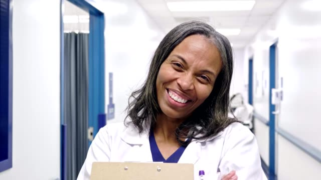 cheerful mature african american female doctor - lab coat stock videos & royalty-free footage