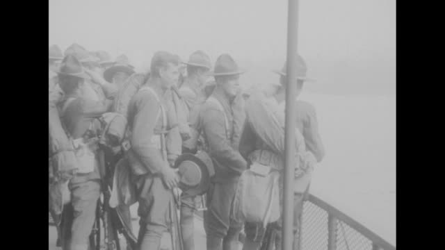 cheerful mexican punitive expedition soldiers waving from the windows of passing train and at the railing of a ferryboat / the flatiron building with... - passing a note stock videos and b-roll footage