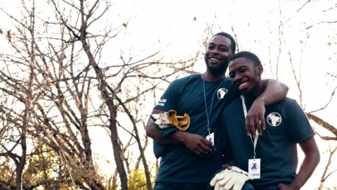 cheerful mid adult man and his teenage son volunteer during community cleanup event - volunteer stock videos & royalty-free footage