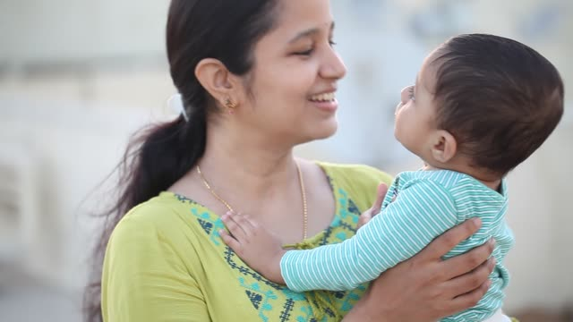 cheerful mother and cute baby boy in outdoors - two people stock videos & royalty-free footage