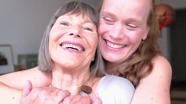 cheerful mother and daughter together at home - two people stock videos & royalty-free footage