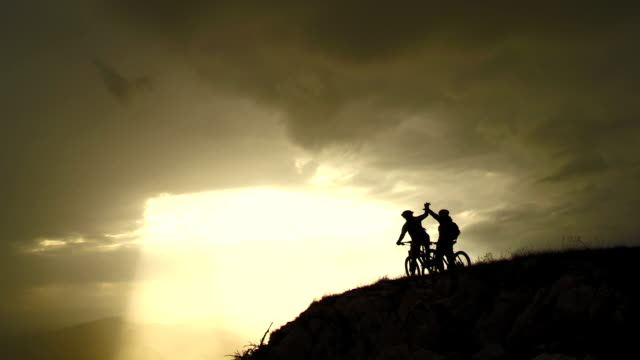 HD CRANE: Cheerful MTB Cyclists On The Top Of Mountain