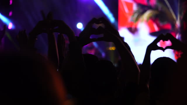 cheerful people crowd making heart by hands at concert - performing arts event stock videos & royalty-free footage