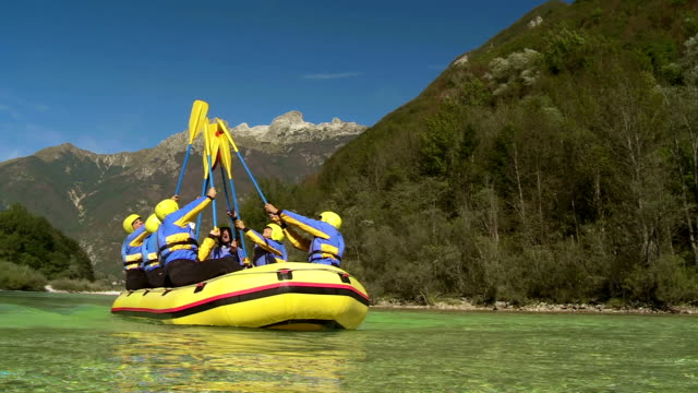 hd: cheerful rafters raising their oars - rafting stock videos and b-roll footage