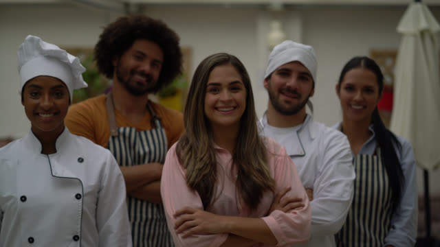 cheerful restaurant team smiling at camera with arms crossed - employee stock videos & royalty-free footage