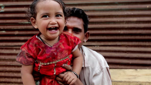 cheerful rural indian father and daughter - affectionate stock videos & royalty-free footage