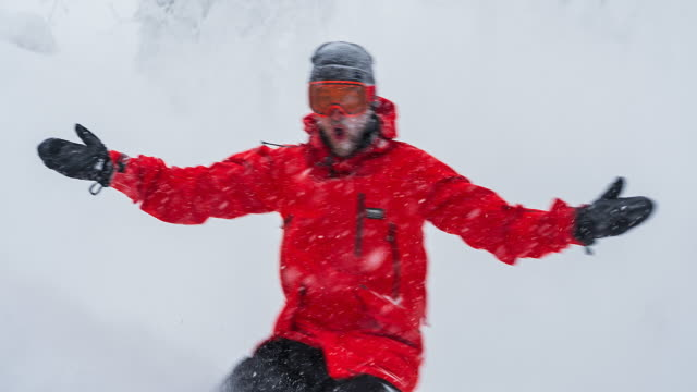 cheerful snowboarder riding backcountry in snowy weather - snowboard video stock e b–roll