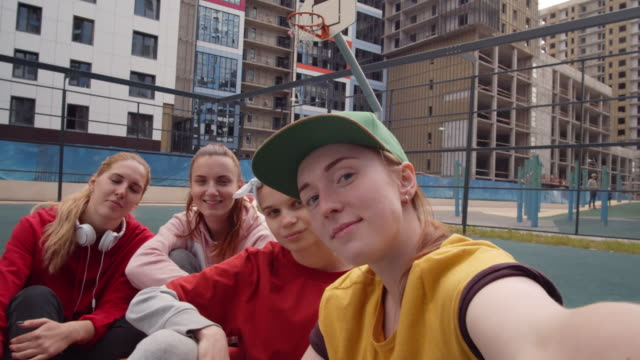 pov of cheerful teen girls taking selfie on outdoor sports court - sitting on ground stock videos & royalty-free footage