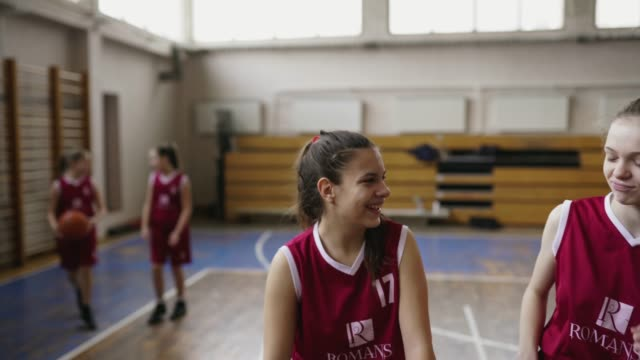 cheerful teenage girls after basketball training - charging sports stock videos & royalty-free footage