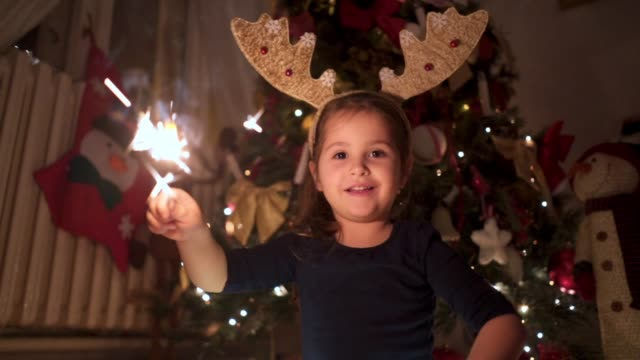 cheerful toddler playing with sparklers on a new year's eve - waving stock videos & royalty-free footage