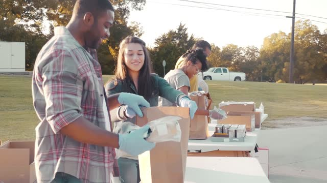 cheerful volunteers working together during food drive - diversity stock videos & royalty-free footage