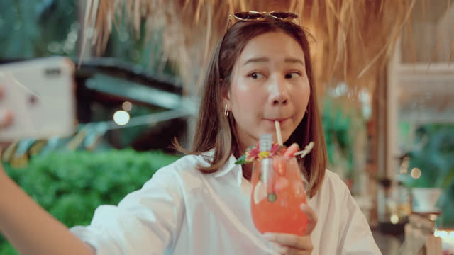 cheerful woman enjoying her drinks. - tropical cocktail stock videos & royalty-free footage