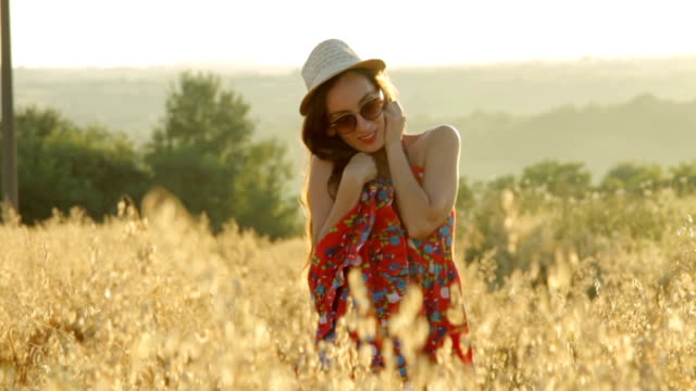 Cheerful woman on sunset. Lifestyle and happiness concept