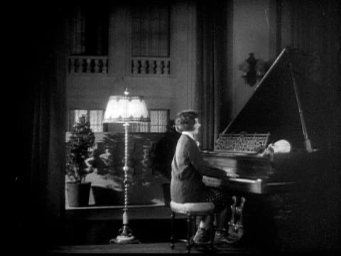 MS, B&W, Cheerful woman playing grand piano, 1920's