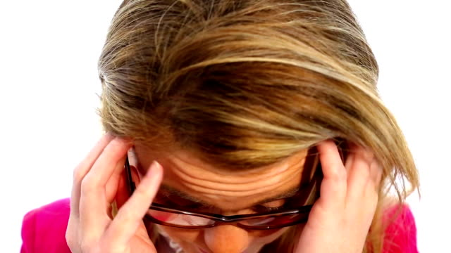 cheerful woman putting on glasses - occhiali da vista video stock e b–roll