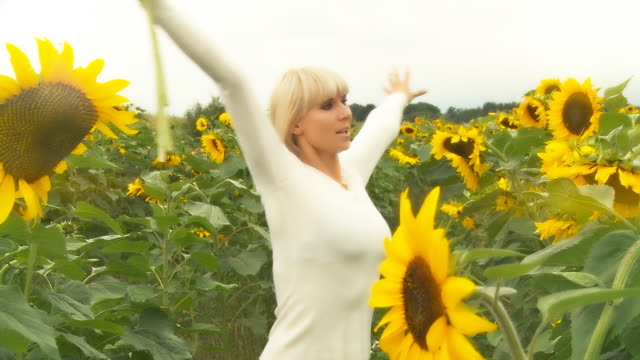 HD: Cheerful Woman With Sunflowers