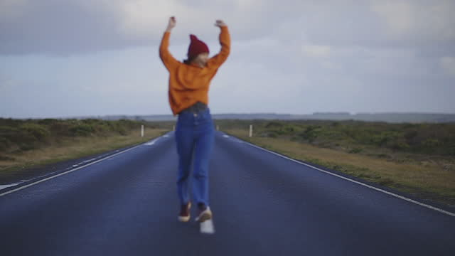 cheerful young adult women running on the great ocean road in australia - active lifestyle stock videos & royalty-free footage