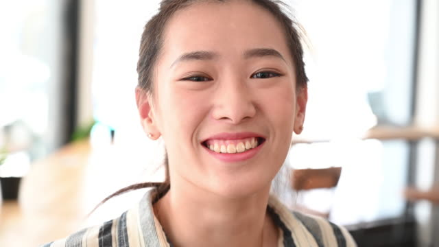 cheerful young chinese woman smiling at camera - taipei stock videos & royalty-free footage
