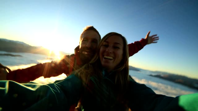 cheerful young couple on mountain top take selfie - sports team stock videos & royalty-free footage